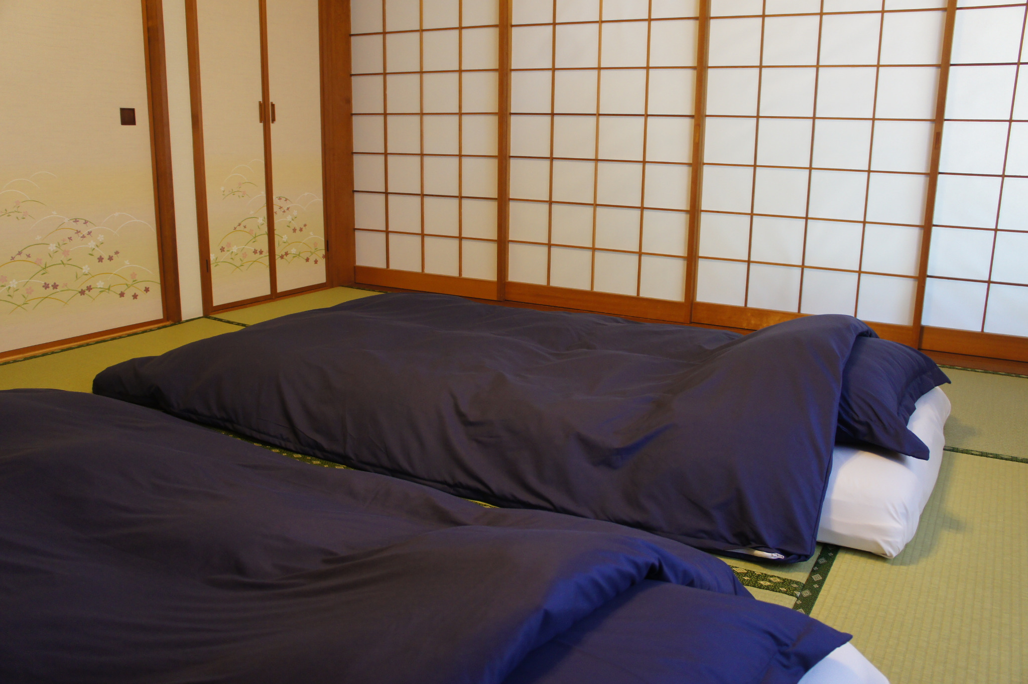 Tatami room on the first floor becomes a bedroom at night.