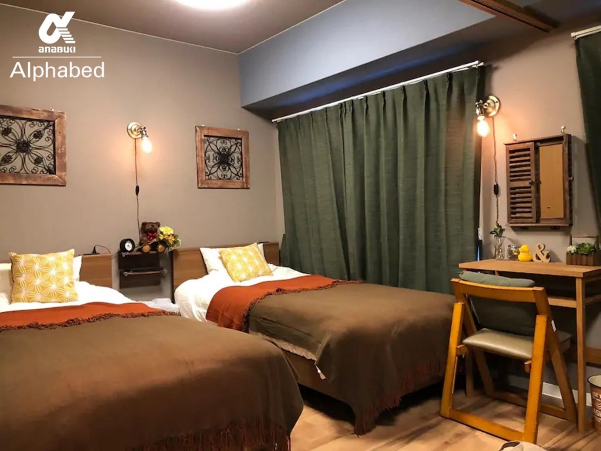 ツインタイプの落ち着きあるマスターベッドルーム